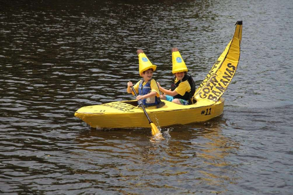 Participants paddle during the Fourth Annual Riverhead Cardboard