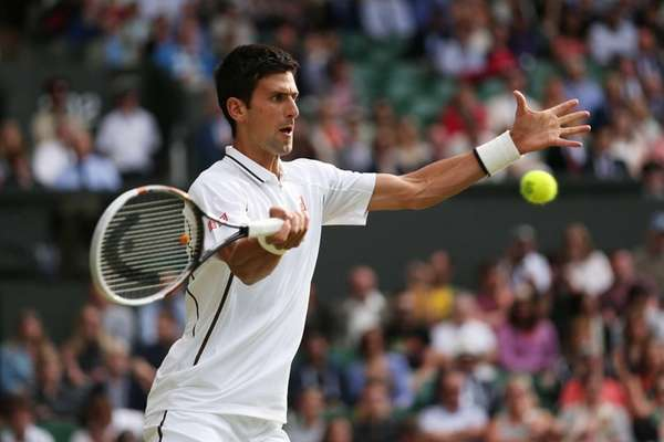 Novak Djokovic of Serbia plays a forehand during