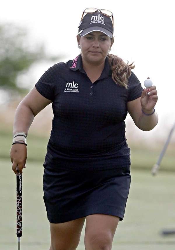 Lizette Salas leaves the 18th after completing play
