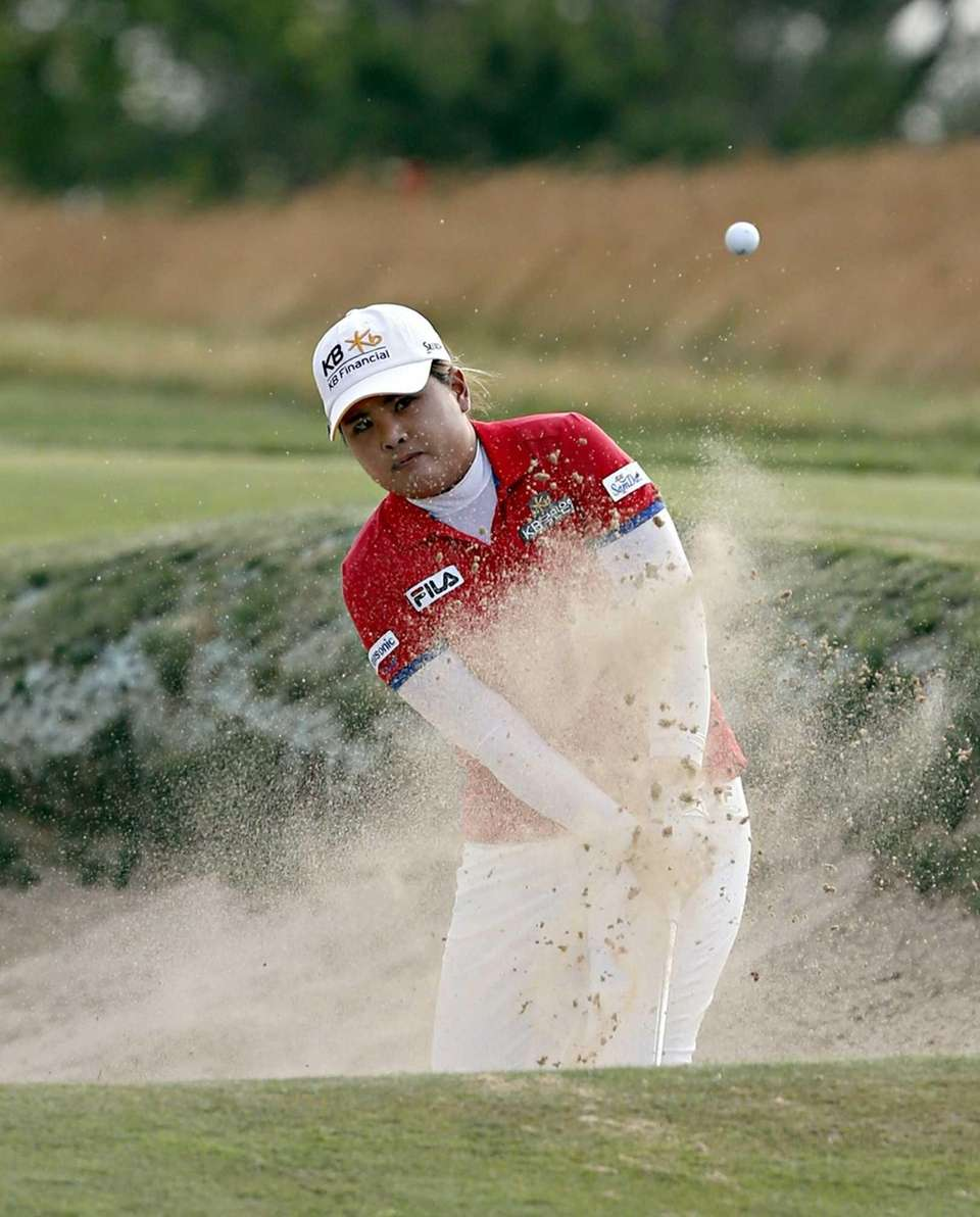 Inbee Park blasts out of a bunker on