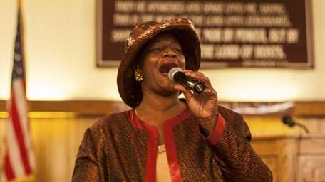 Church Musician Beverly Cox sings during a concert