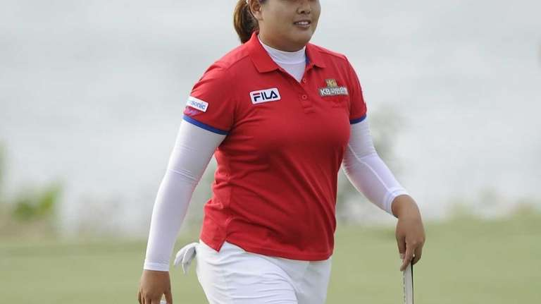 Inbee Park walks from the 18th green after