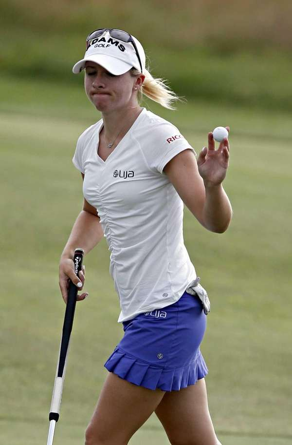 Jodi Ewart Shadoff leaves the 18th green acknowledging