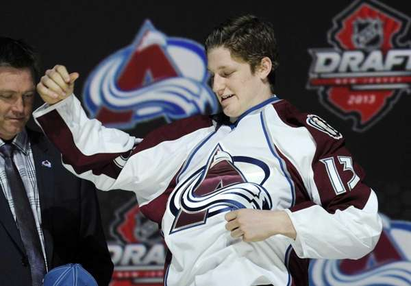 Nathan MacKinnon, a center, pulls on a Colorado