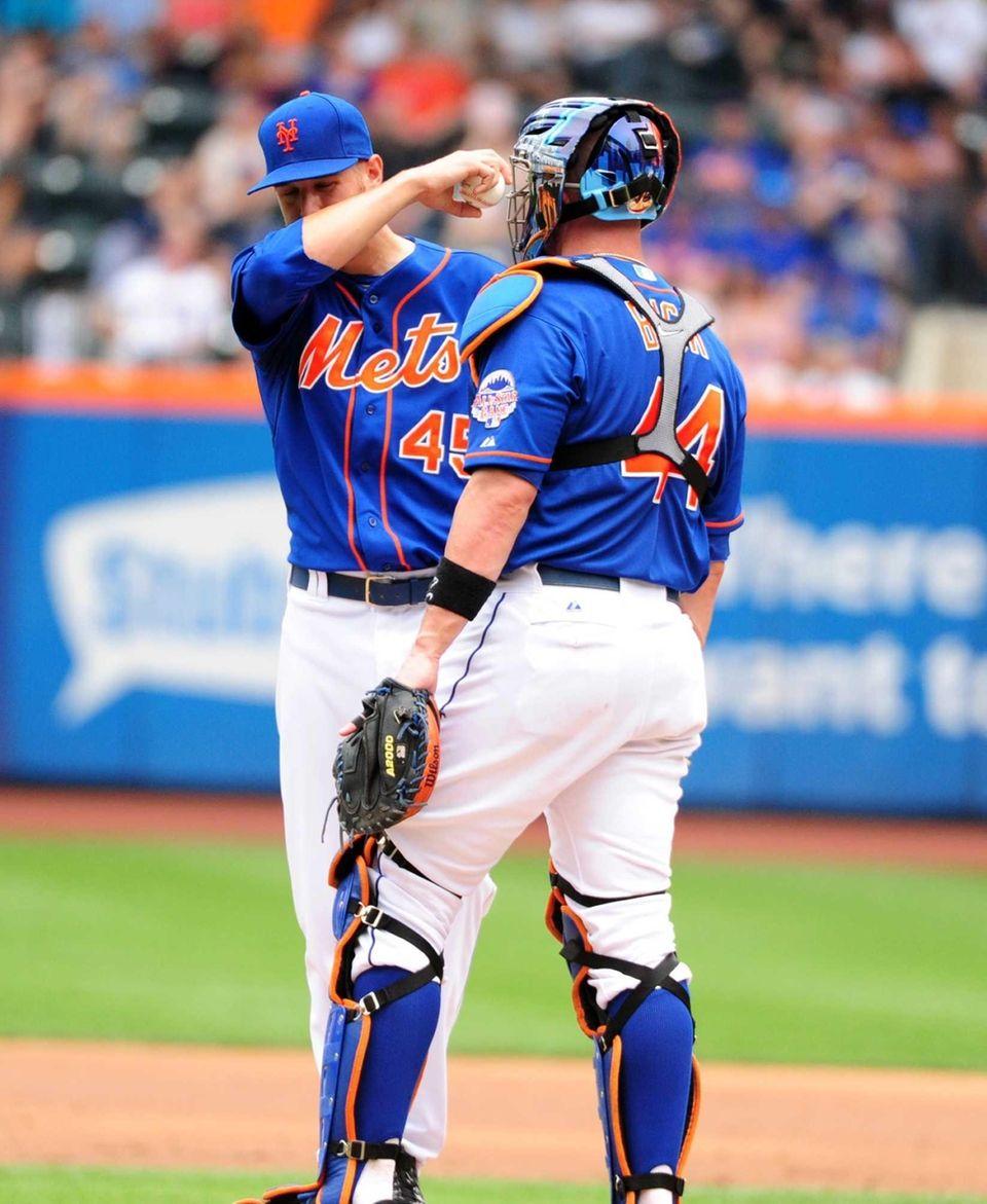 Mets starting pitcher Zack Wheeler, left, and catcher