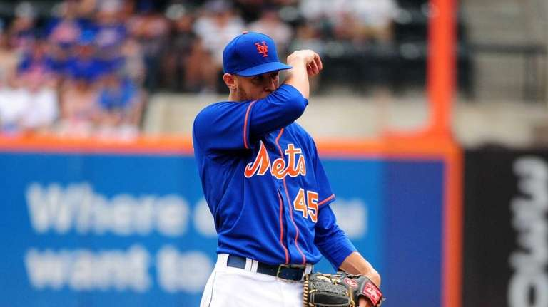 Mets pitcher Zack Wheeler reacts during the second