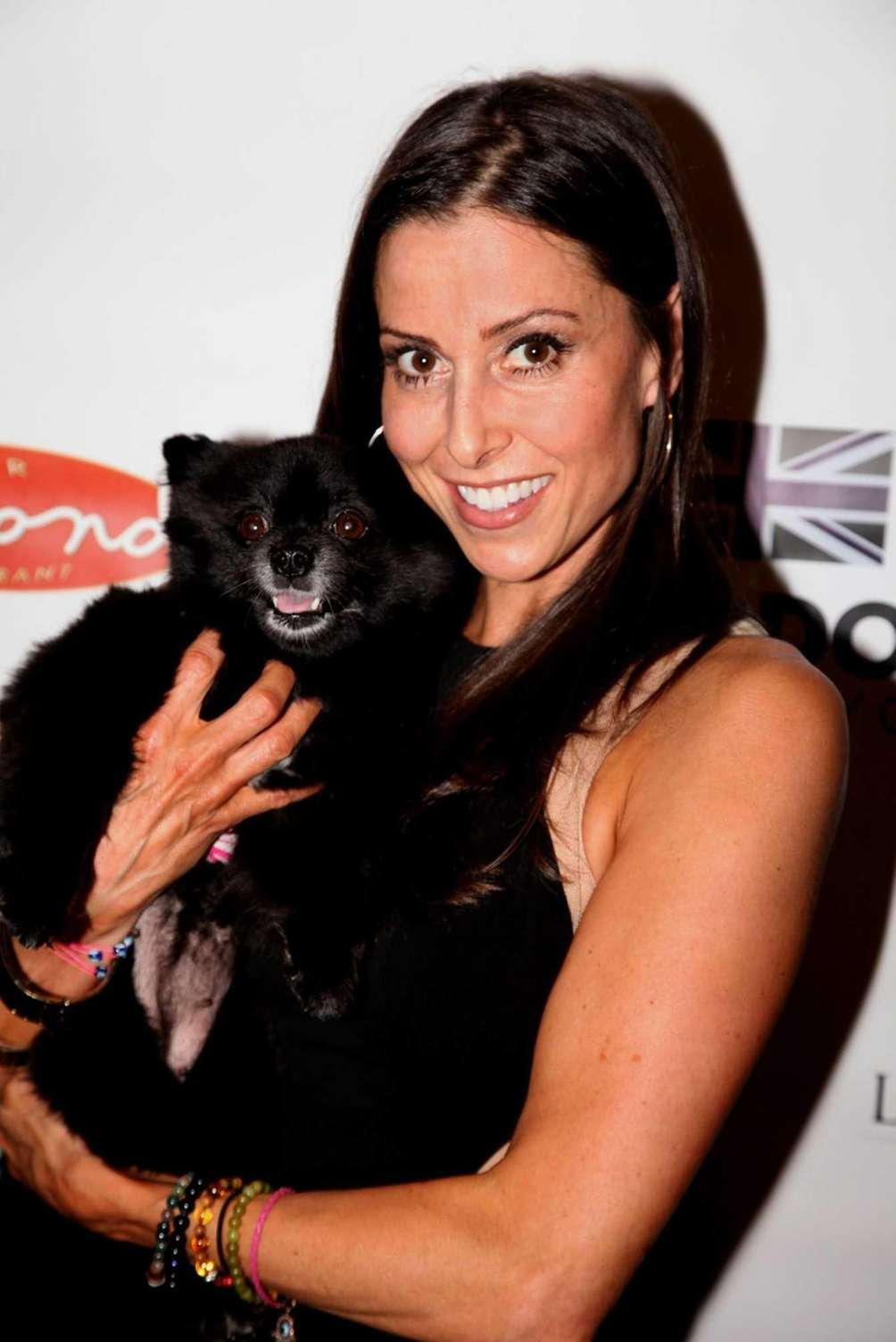Christine Montanti and her dog, Snowball, attend the