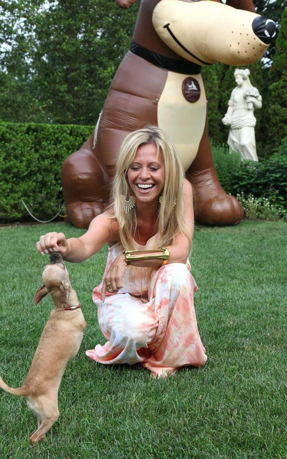 Dina Manzo shares a treat with her dog,