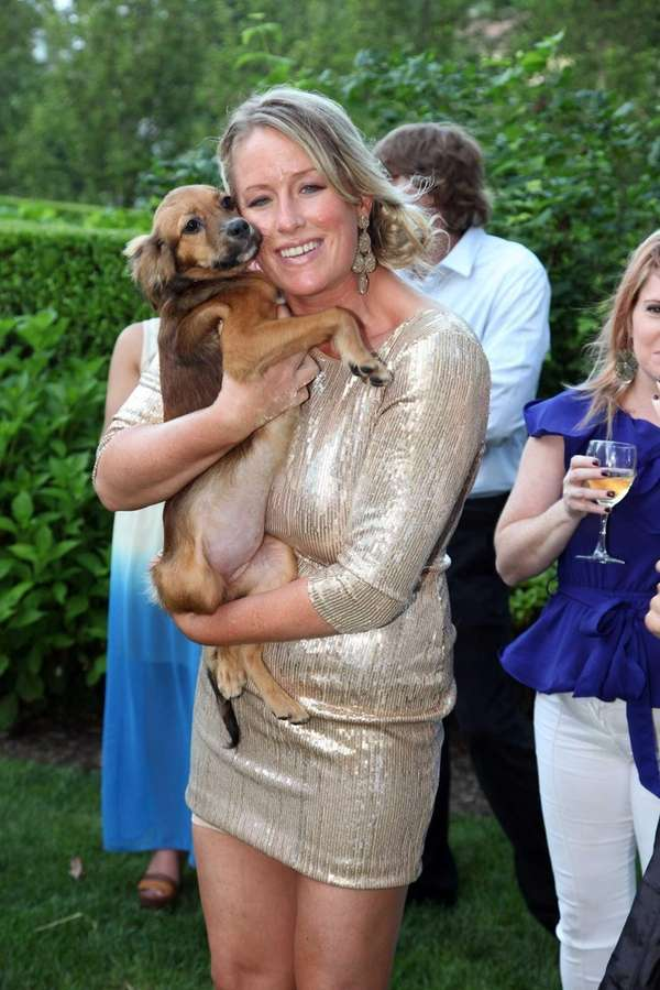 Whitney Knowlton and her dog, Minka, attend the