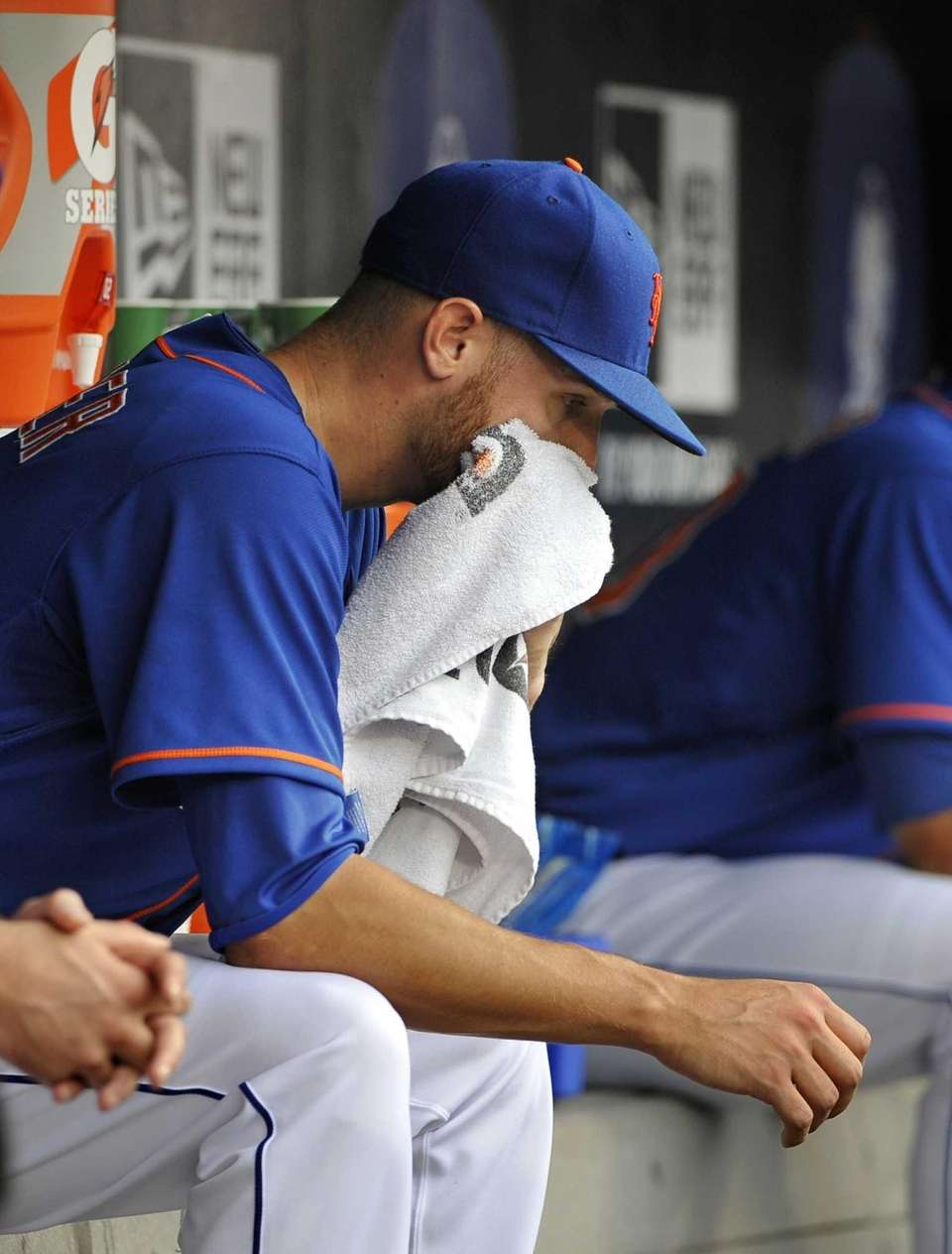 Mets starting pitcher Zack Wheeler sits in the