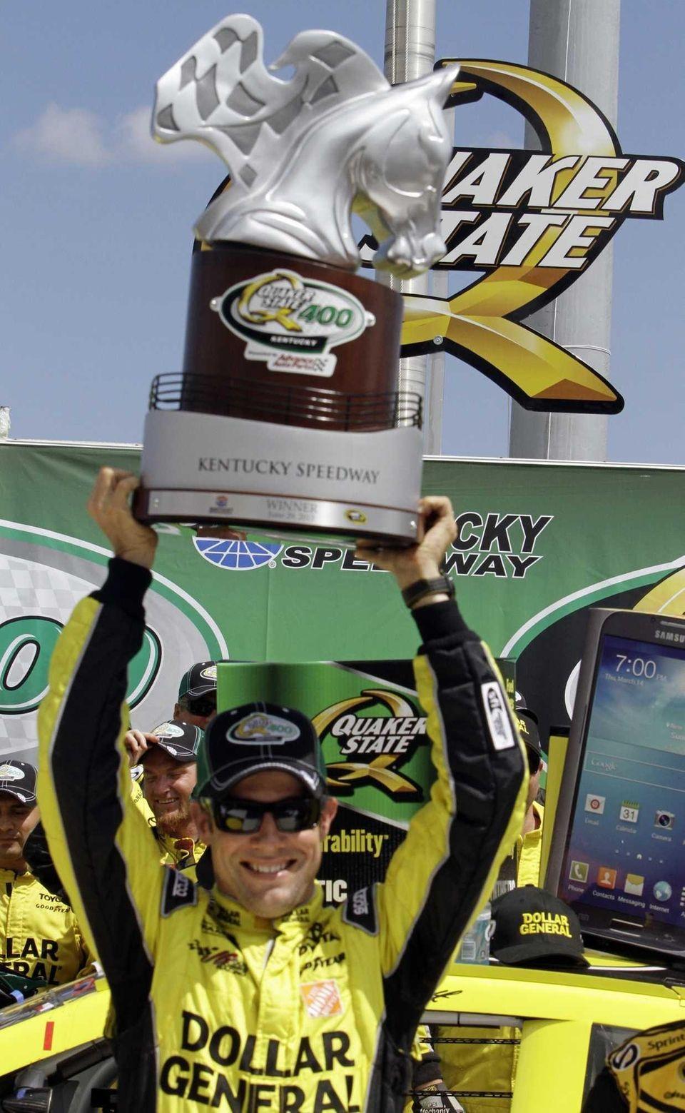 Matt Kenseth celebrates his victory in the NASCAR