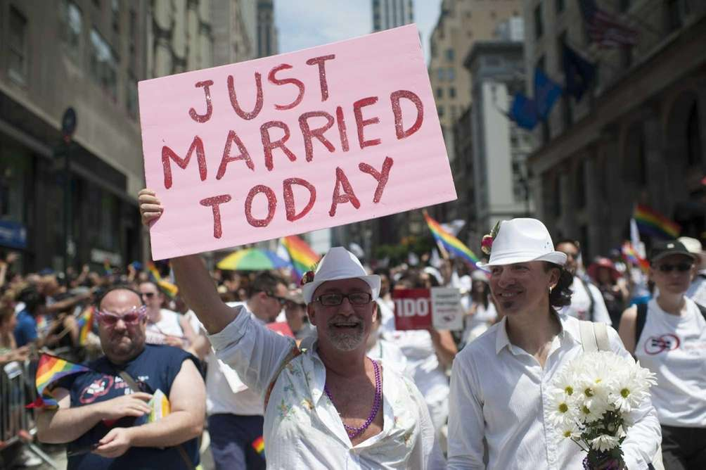 Participants march in the 2013 NYC Pride parade,