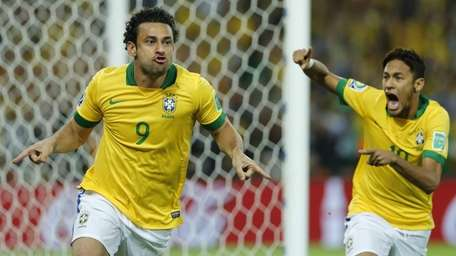 Brazil's Fred, left, and Neymar celebrate after Fred