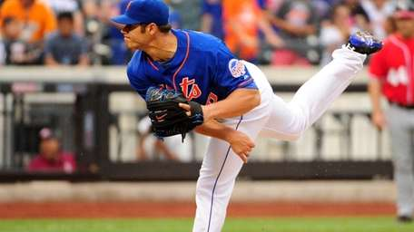 Mets catcher Anthony Recker delivers a pitch in