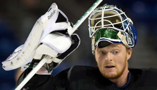 Vancouver Canucks goalie Cory Schneider leaves the ice