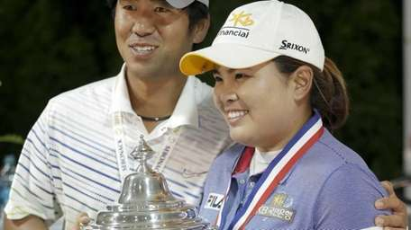 Inbee Park, right, poses for a picture with