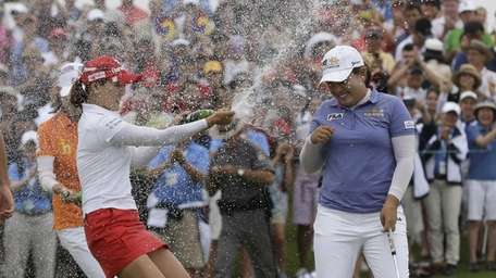 Inbee Park is sprayed with champagne after sinking