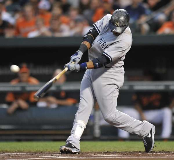 Robinson Cano singles against the Baltimore Orioles in