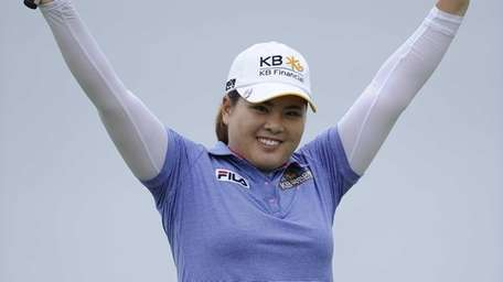 Inbee Park reacts as she wins the 2013