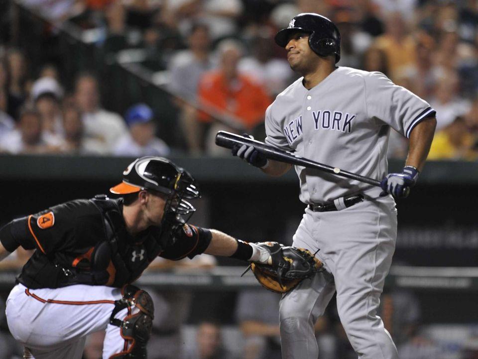 Baltimore Orioles catcher Matt Wieters, left, tags out