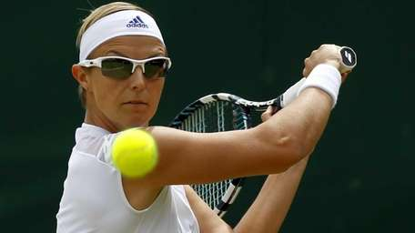 Kirsten Flipkens of Belgium, above, stopped play to