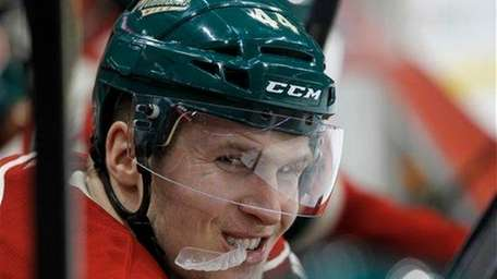 Minnesota Wild defenseman Justin Falk smiles at a