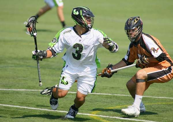 Rob Pannell, left, of the Lizards plays against