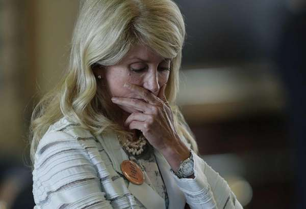 Sen. Wendy Davis reacts after she was called