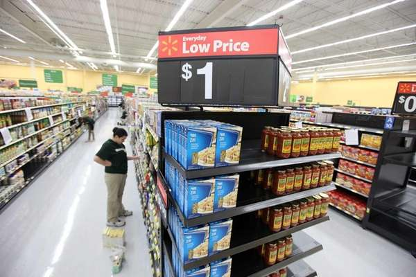 Workers stock the shelves of what will be Long Island's first Walmart Neighborhood Market in Levittown, set to open on July 10. (July 1, 2013)