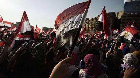 Egyptian opposition protesters celebrate in Cairo's landmark Tahrir