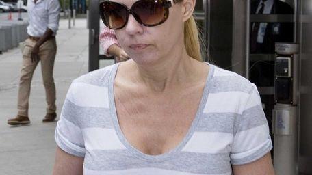 Andrea Sanderlin leaves federal court after making bail