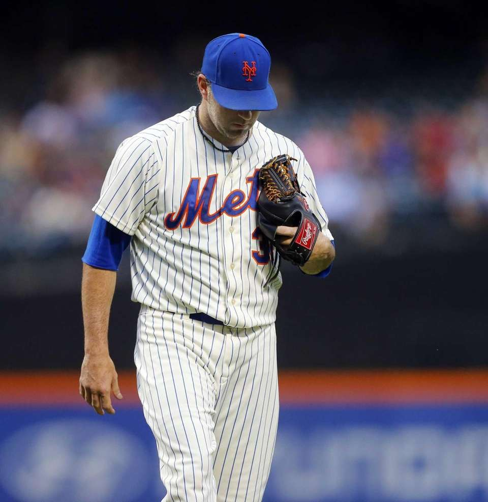 Shaun Marcum of the Mets walks to the