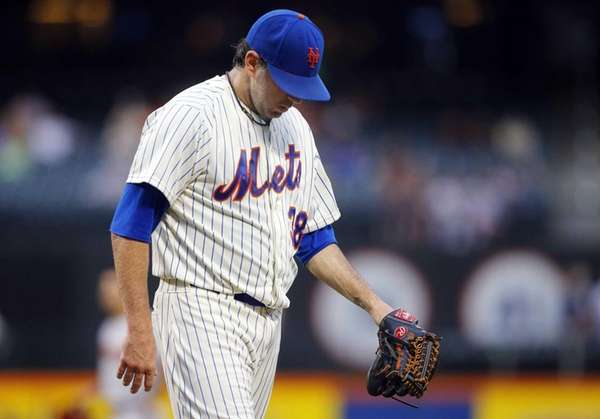 Shaun Marcum of the Mets walks to the
