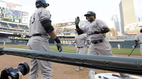 Robinson Cano, right, is all smiles as he