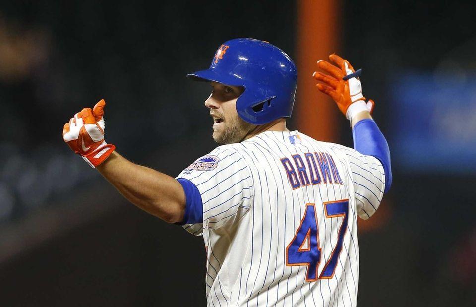 Andrew Brown celebrates his two-run game-winning base hit