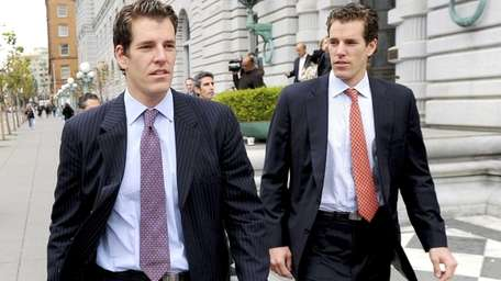 Tyler Winklevoss, left, and his twin brother Cameron,