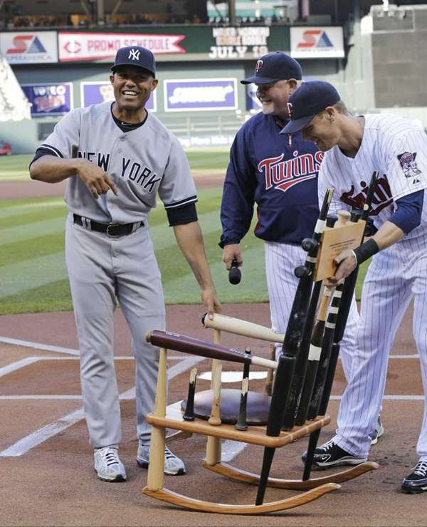 """Mariano Rivera reacts to receiving the """"Chair of"""