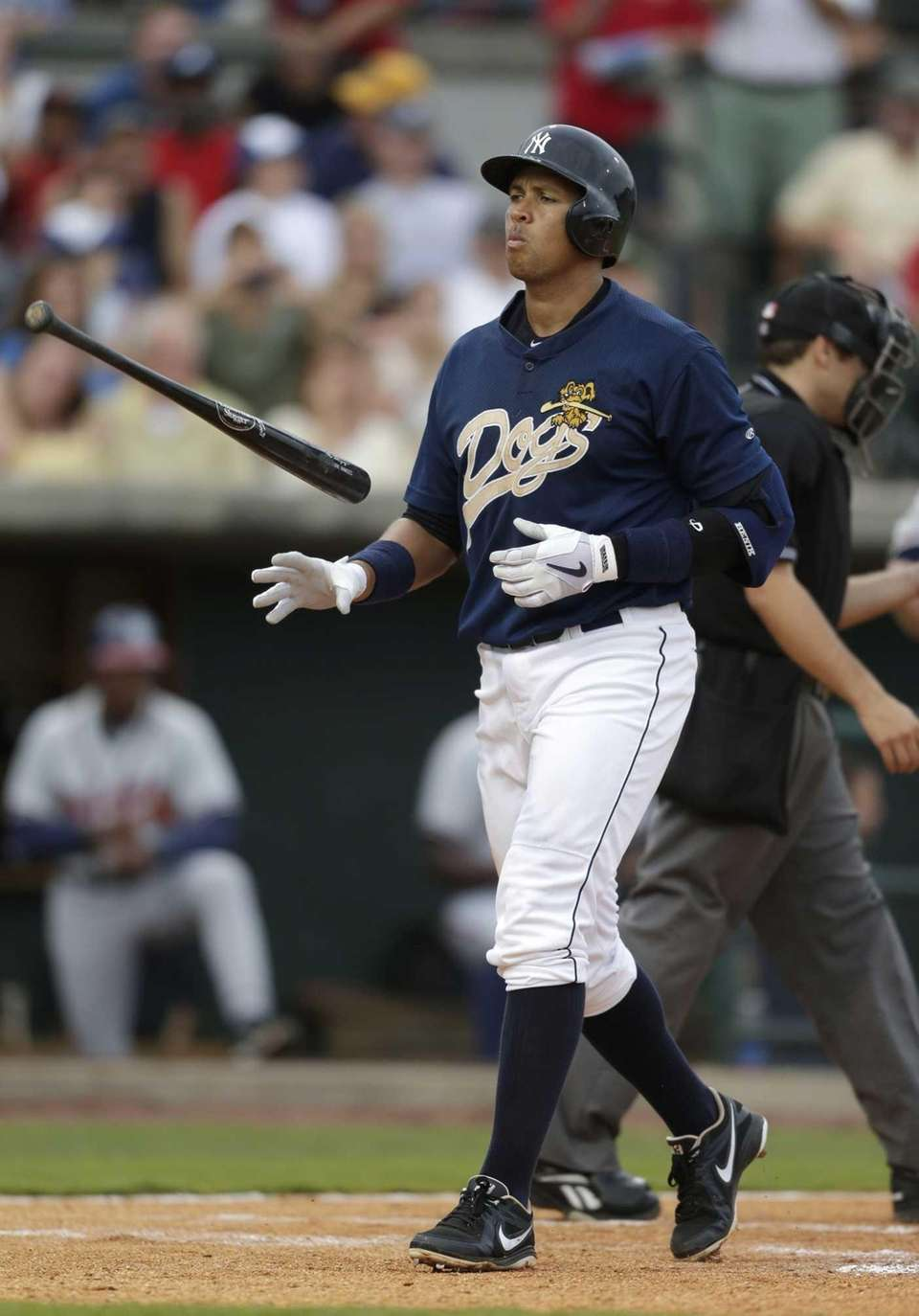 Alex Rodriguez reacts after striking out during the