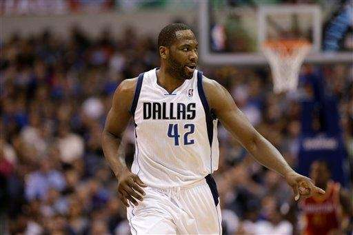 ??Dallas Mavericks forward Elton Brand reacts during a