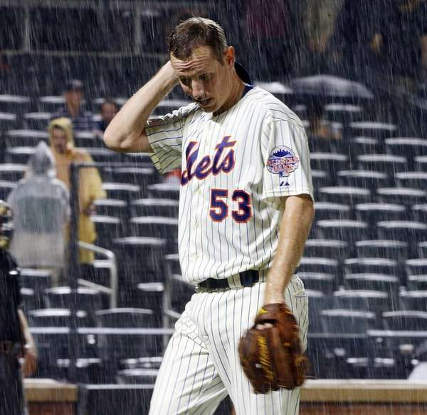 Jeremy Hefner of the Mets walks off the