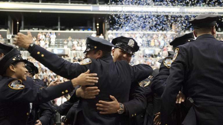 New York City Police Academy cadets celebrate at