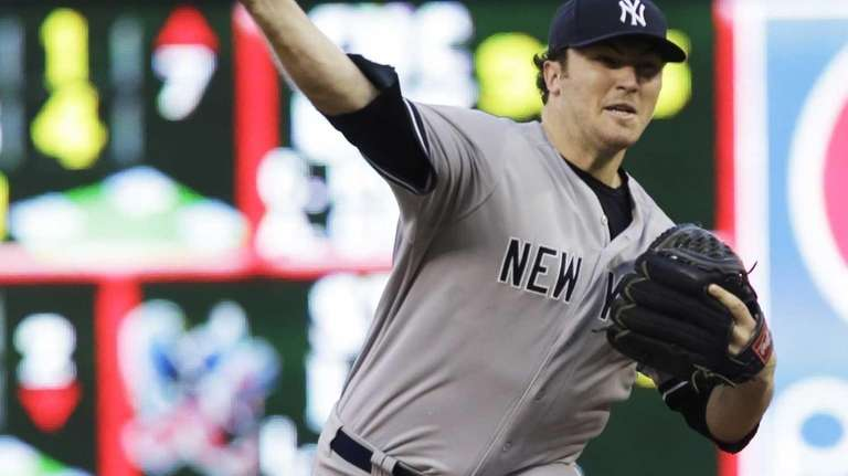 Yankees pitcher Phil Hughes throws against the Minnesota