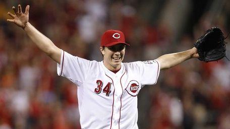 Cincinnati Reds pitcher Homer Bailey celebrates after throwing