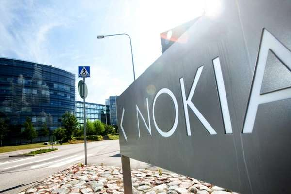 A sign stands outside the headquarters of Nokia
