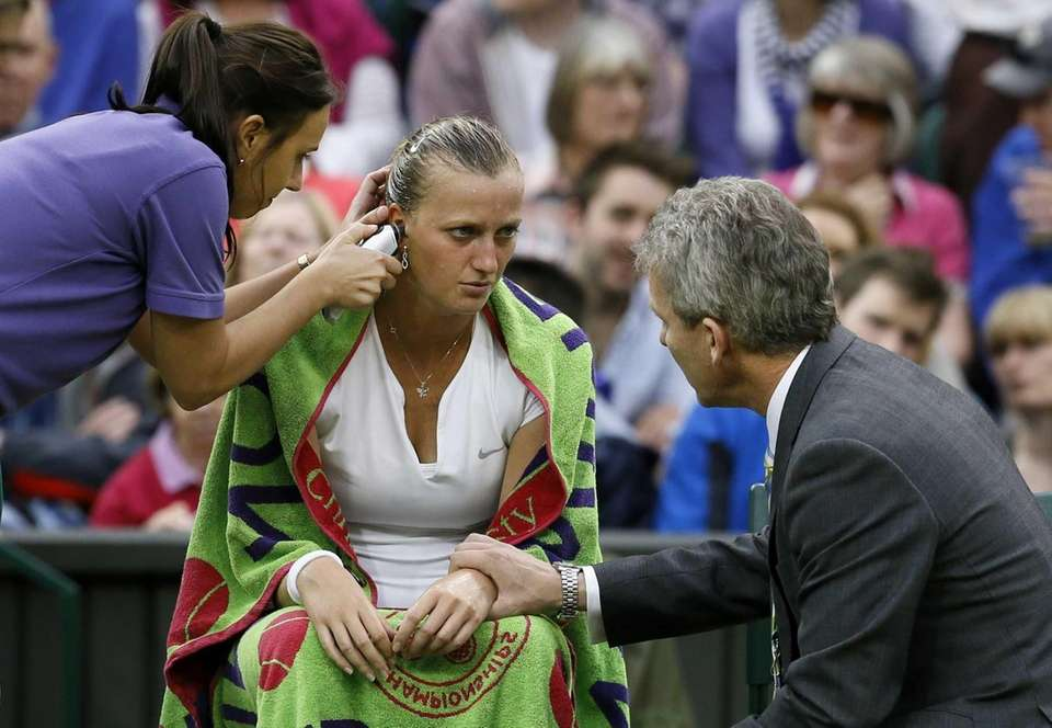 Petra Kvitova of the Czech Republic is attended