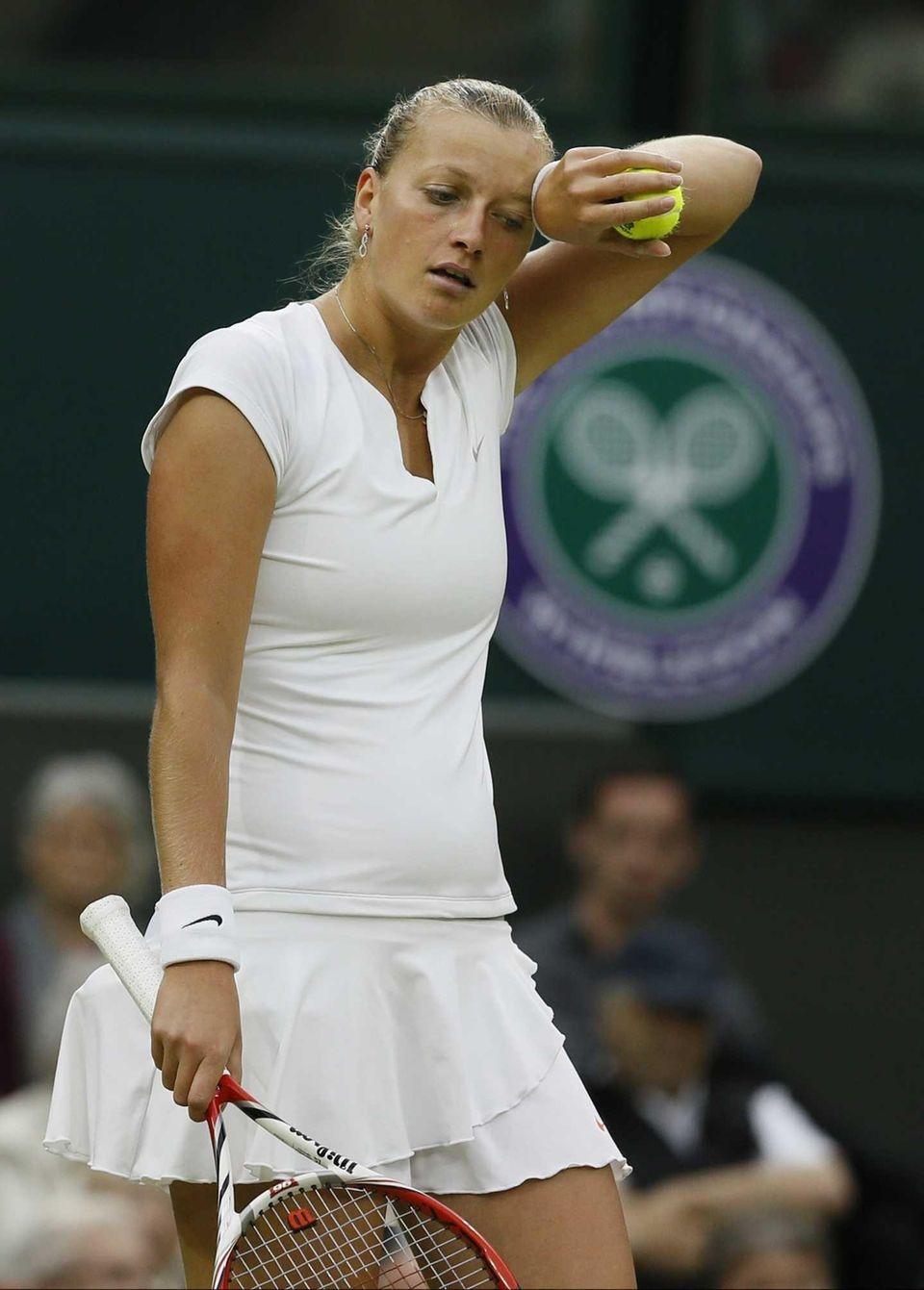 Petra Kvitova of the Czech Republic wipes her