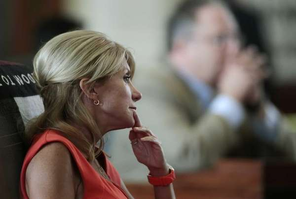 Texas Sen. Wendy Davis sits at her desk