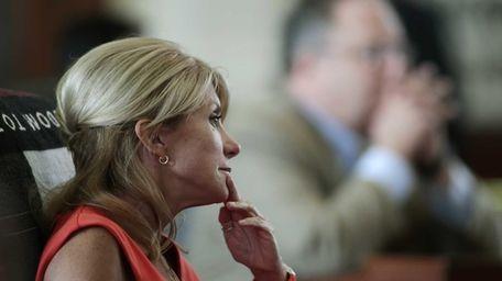 Texas Sen. Wendy Davis sits at her desk