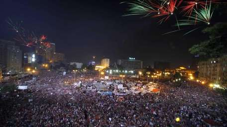 Fireworks light the sky as opponents of Egypt's