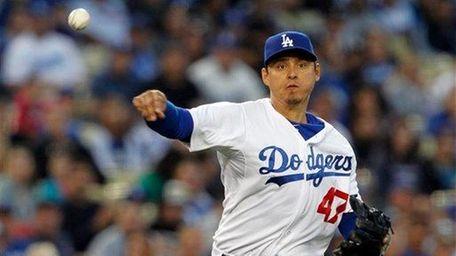 Los Angeles Dodgers third baseman Luis Cruz throws
